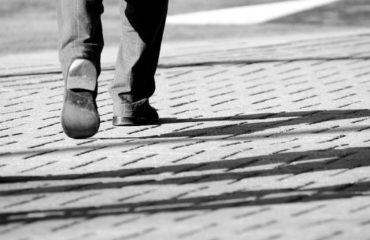 Image of job applicant walking - criminal record checks in pre-employment screening