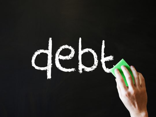 Image of a hand wiping away the word 'debt'
