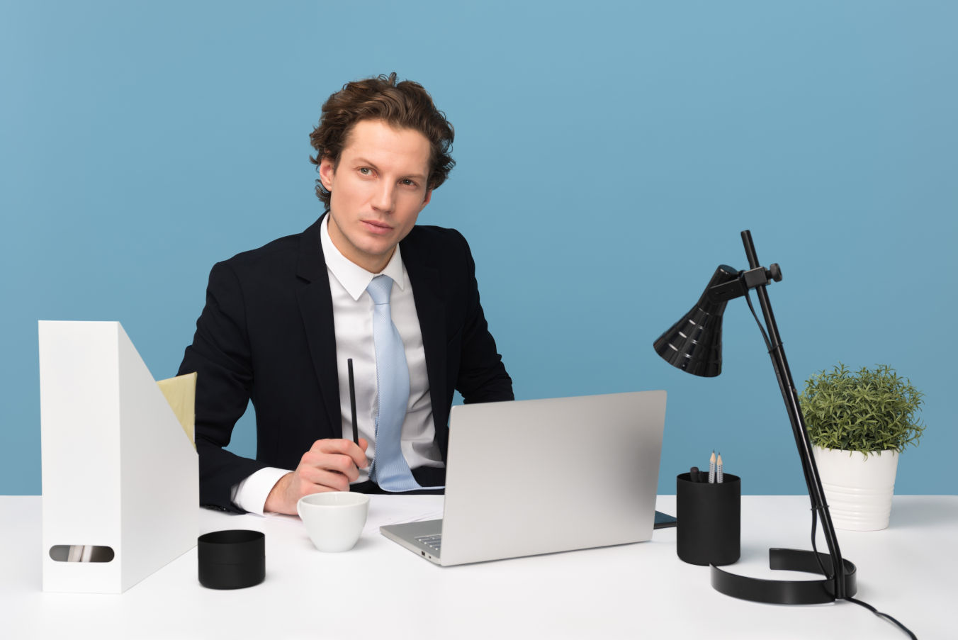 Job interviewer sitting behind a desk with a critical expression.