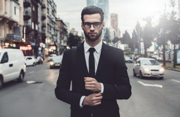 Human capital risk - a business man standing in traffic