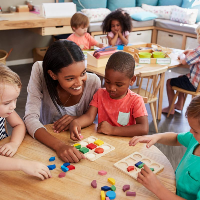 CarerCheck - Image of a pre-school teacher and young children